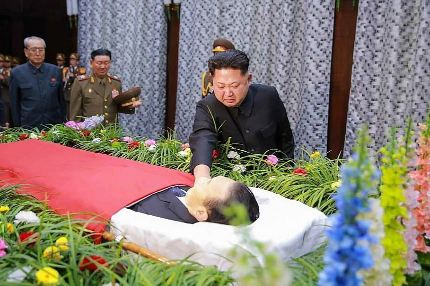 Mr Kim Jong Un paying his last respects to Mr Kim Yang Gon, whom he described as