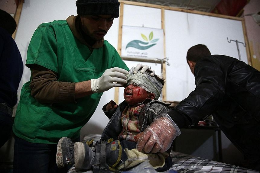 A child receiving treatment in a makeshift hospital following a reported air strike by Syrian government forces on the rebel-held town of Douma on the eastern edge of the capital Damascus on Wednesday. Syria's war has forced more than four million pe