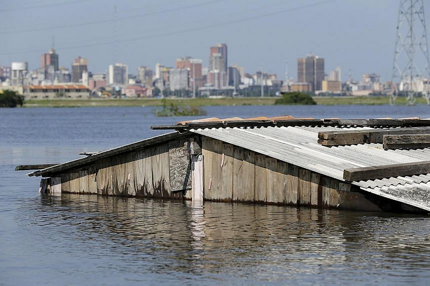 A house nearly submerged in floodwaters in Paraguay's capital, Asuncion, on Wednesday.
