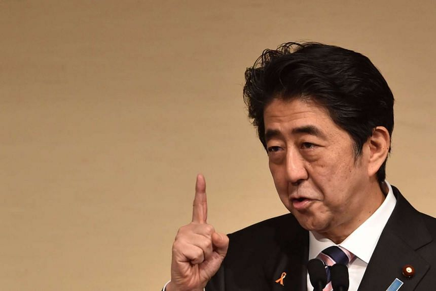 Japan's Prime Minister Shinzo Abe delivers a speech during the Yomiuri International Economic Society (YIES) lecture meeting.