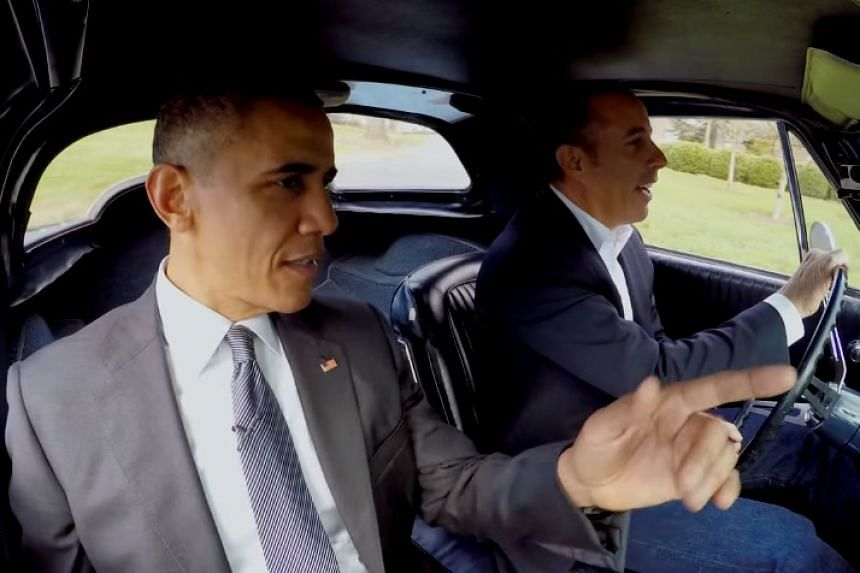 A screenshot of Obama being driven around the White House grounds by Jerry Seinfeld.
