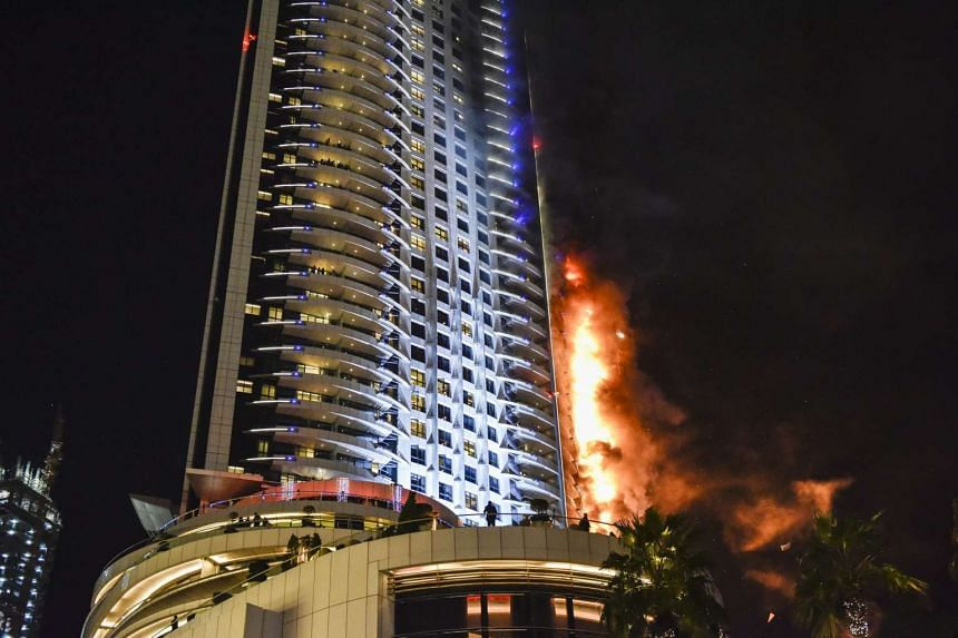Flames and smoke are seen after a fire broke out at The Address Hotel in Dubai on Dec 31, 2015.