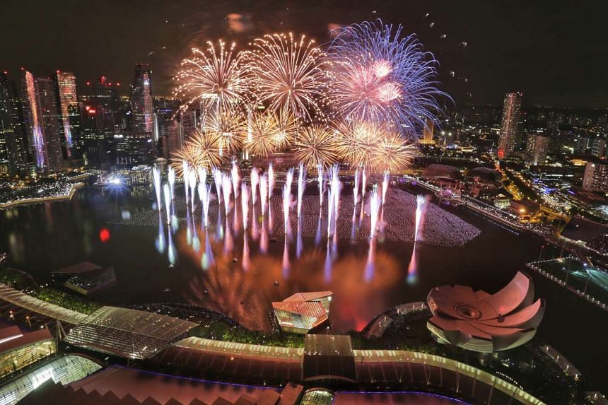 Fireworks going off at Marina Bay on Jan 1, 2016.