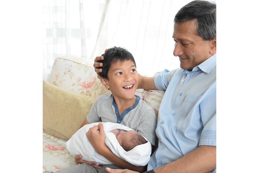 Dr Vivian Balakrishnan with his son Luke and his grandson.