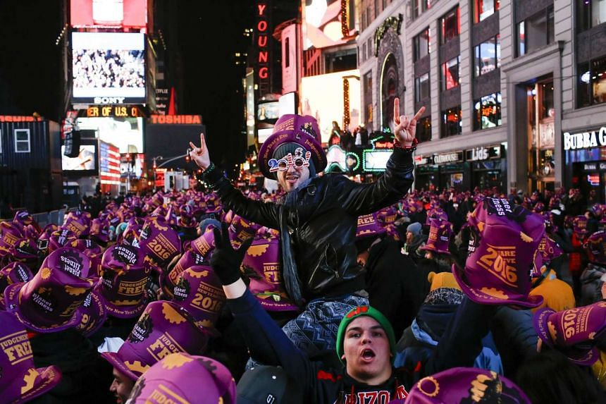 People take part during New Year's Eve celebrations on Dec 31, 2015 in New York City.