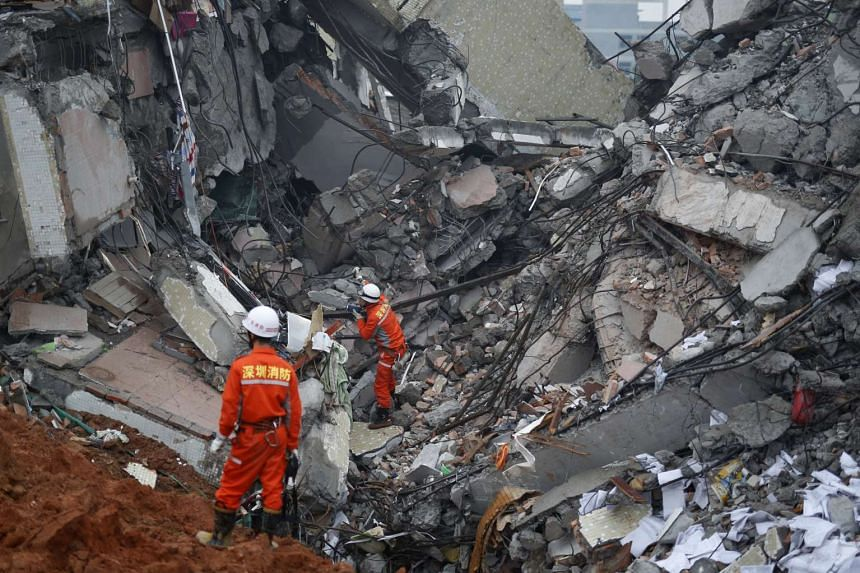 Firefighters search for survivors among the debris of collapsed buildings after a landslide hit an industrial park in Shenzhen.