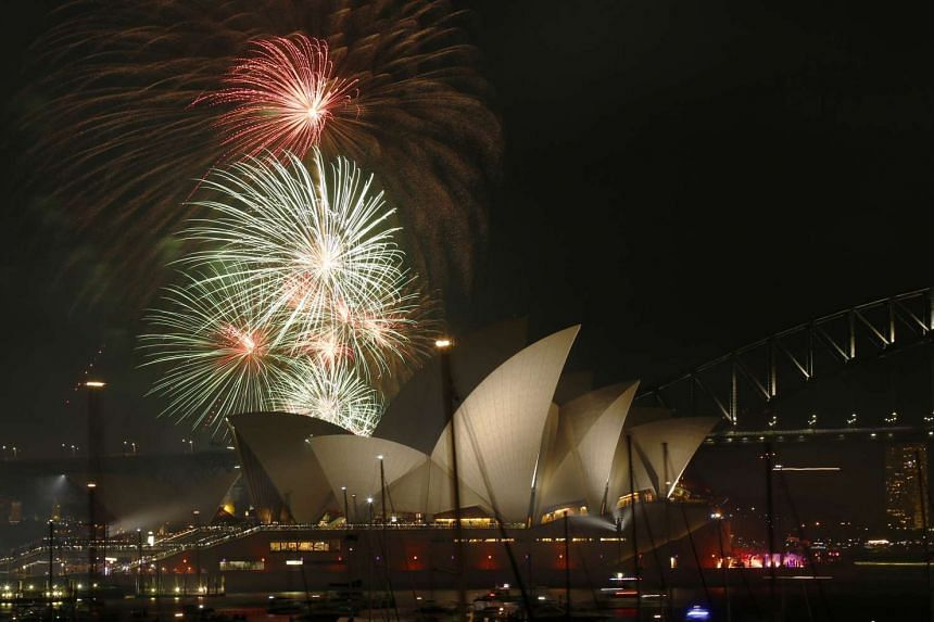 A fireworks display over the Sydney Opera House in a 9pm show before the midnight fireworks that will usher in the new year in Australia's largest city. Thousands gathered at Sydney Harbour yesterday to be among the first in the world to usher in 201