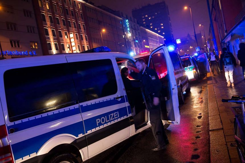 German police stand guard outside the main railway station in central Munich, Germany on Dec 31, 2015.