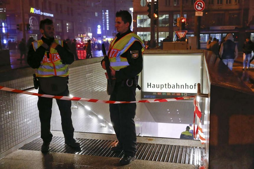 German police secure the area near the main train station in Munich on Jan 1, 2016.