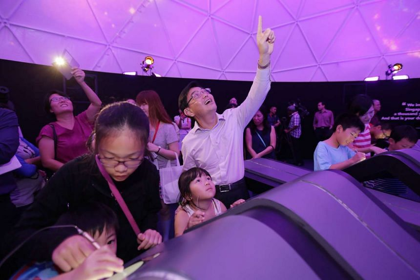 Finance Minister Heng Swee Keat with visitors at The Future Of Us exhibition.