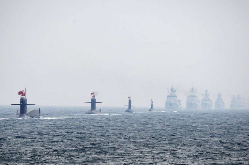 Chinese submarines and warships taking part in a fleet review in 2009.