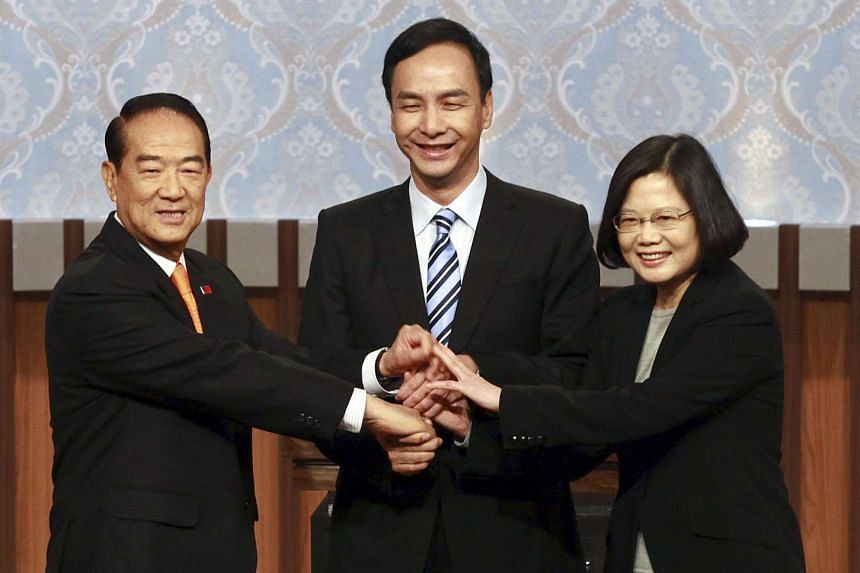 People First Party chairman James Soong (left) shaking hands with Democratic Progressive Party chairman Tsai Ing-wen (right) and Nationalist Party chairman Eric Chu before a televised debate in Taipei on Dec 27, 2015.