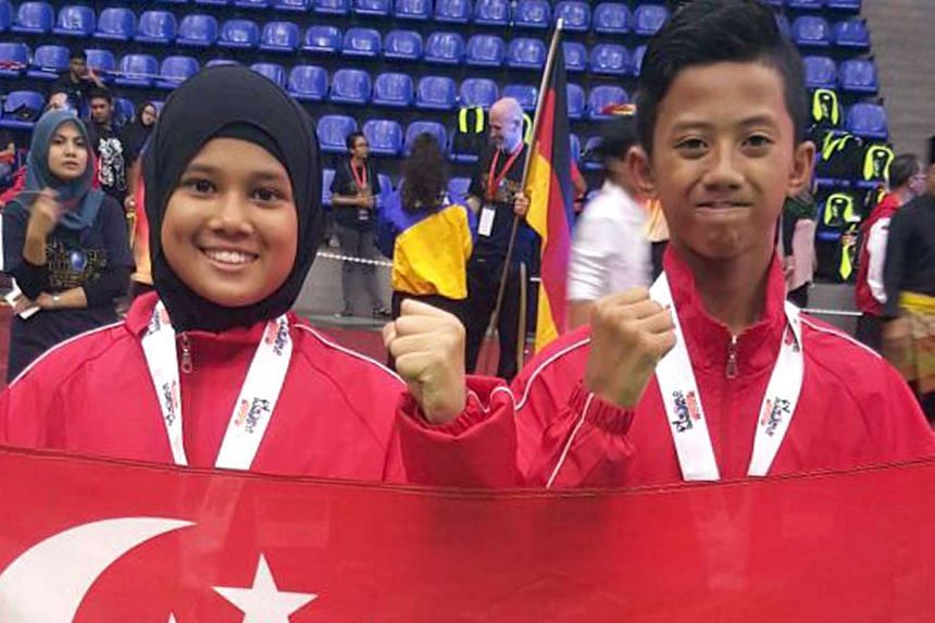 Hazim Yusli (right) and Shafizah Shazza Shamsuri at the recent World Silat Junior Championships on Dec 31, 2015.