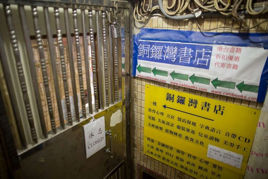 A 'closed' sign hanging on the door of the Causeway Bay Bookstore in Hong Kong, China, on Jan 2, 2016.
