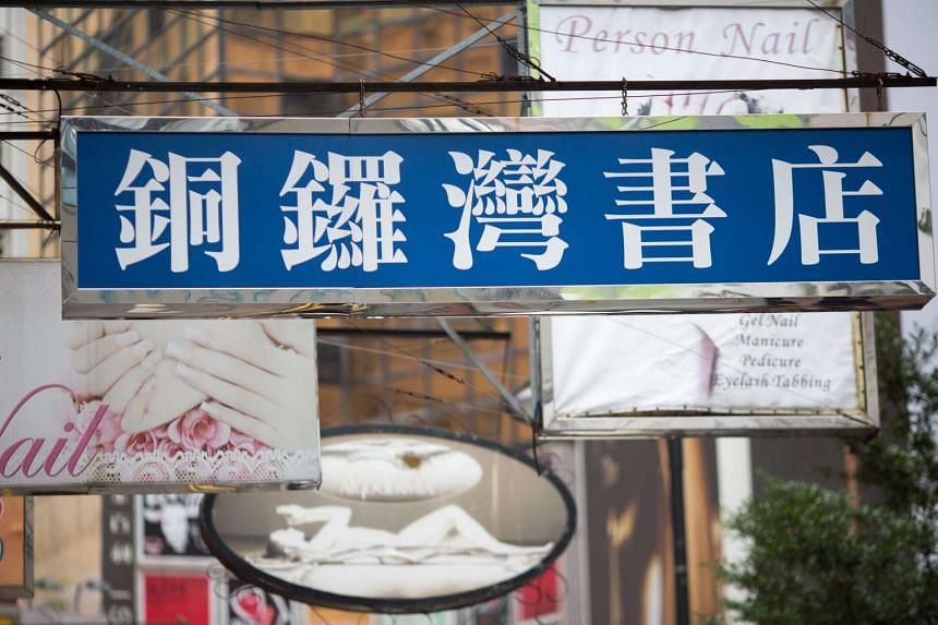 A sign for Causeway Bay Books hangs outside the bookstore in Hong Kong, China.