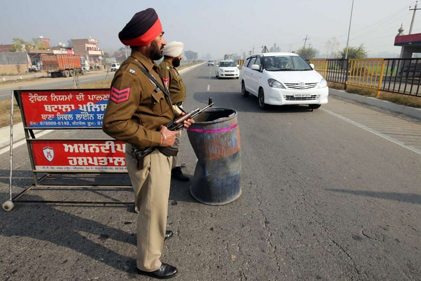 Punjab police personnel man a checkpoint in wake of high security alert sounded across the state of Punjab, following militant attacks at the Air Force base Pathankot, on Amritsar-Pathankot highway near Batala, some 65km from Pathankot, India, on Jan