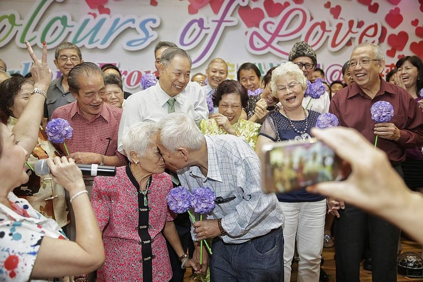 Mr Chuang Pek Chow and Madam Foo Swee Moy renewing their vows with a kiss alongside other couples at Colours of Love, an event aimed at celebrating marriage and family life. Madam Foo, who believes the secret of their marriage is mutual compromise, s