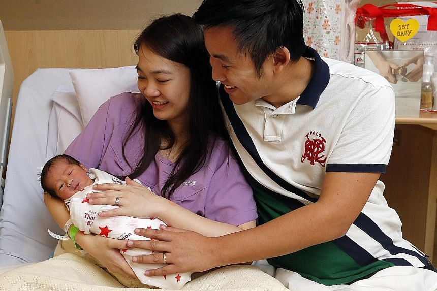 Mr Tan and Ms Chen with Evan. The 2.7kg infant had been due to arrive on Jan 9, but became Singapore's first New Year baby instead, with two other babies sharing his birthday less than a minute later.