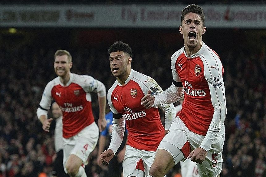 Gabriel (above) racing away after opening accounts in Arsenal's 2-0 home win over Bournemouth. The leaders will hope to be fourth-time lucky as they have been top on New Year's Day three times in the last 14 years but missed out at the end.