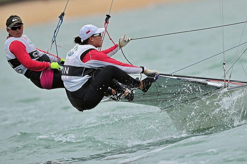 Singapore sailors Griselda Khng (left) and Sara Tan won gold in the 49erFX skiff class at the SEA Games and aim to make it to Rio after internal trials. Much of the $60,000 total funding for their quest has been provided by their parents.