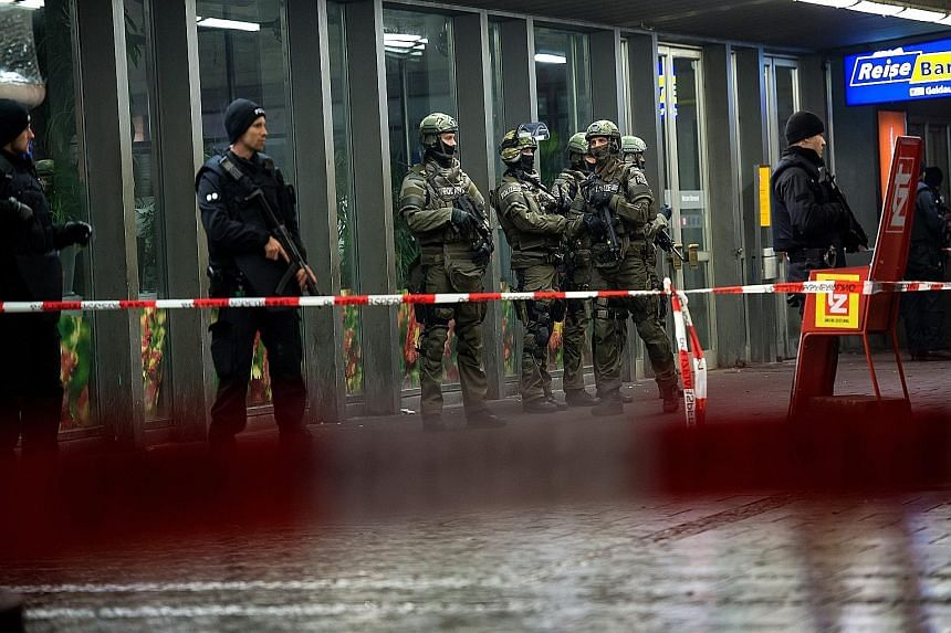 Police at Munich's main railway station on New Year's Eve. Officials had been tipped off about an ISIS plot to strike the city.