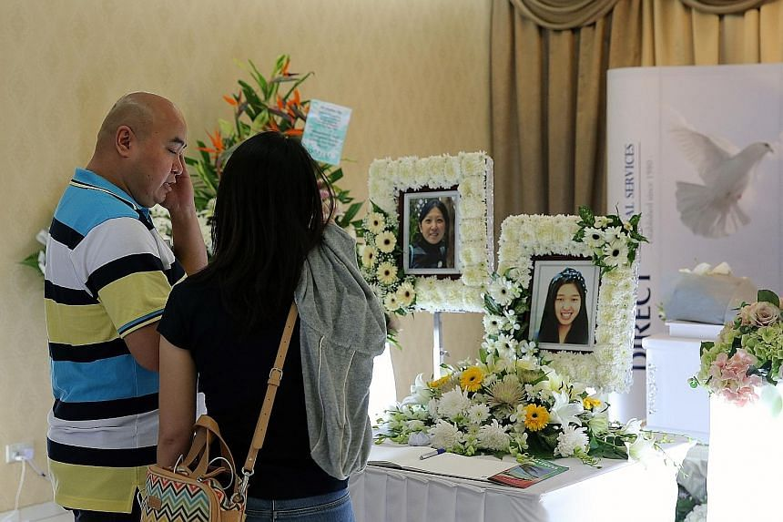 Mr Stephen Yap at the wake for his daughter Vivian yesterday. The 16-year-old died in a boating accident in the Maldives with her mother Nicole Tsai. Madam Tsai was cremated in Sri Lanka and her remains sent to Taiwan. Her photo was placed near her d