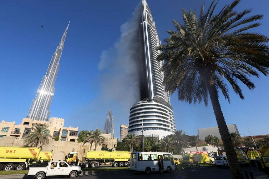 Smoke rises from the hotel in Dubai the day after it caught fire on New Year's Eve.