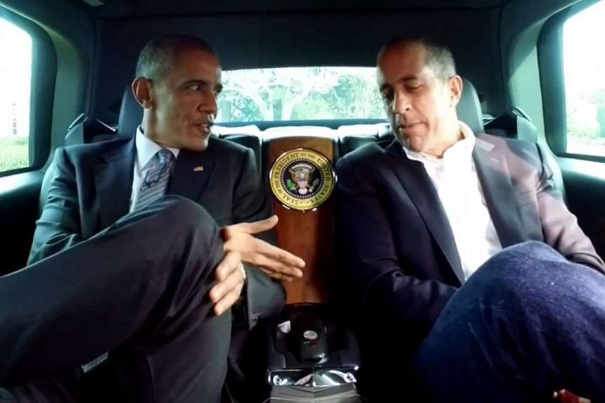 President Obama (above left) showing off the interior of the presidential Cadillac to comedian Jerry Seinfeld.