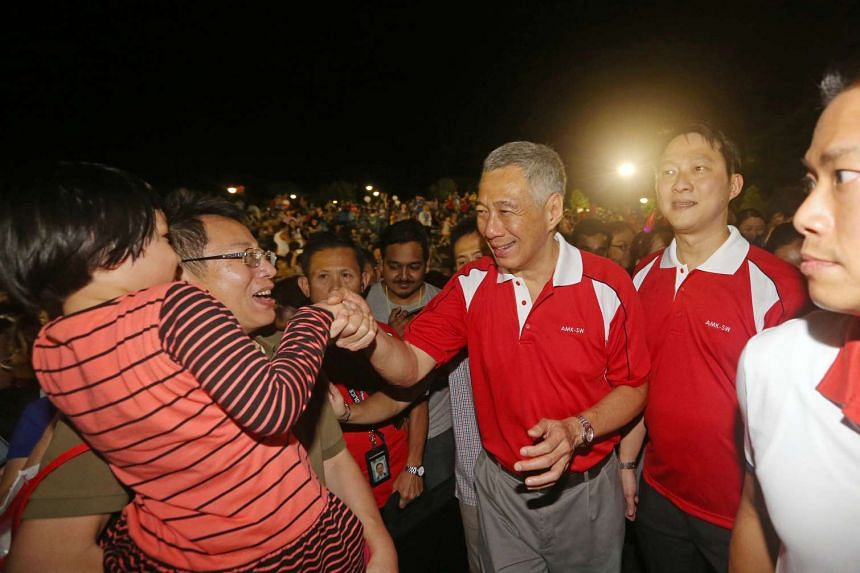 Prime Minister Lee Hsien Loong meeting residents at the countdown party held at Sengkang Riverside Park.