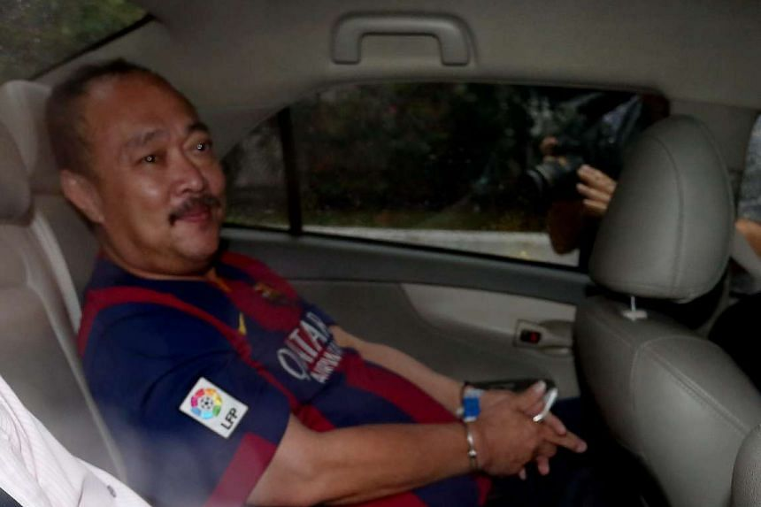 Toh Hock Thiam arriving at the State Courts in a police car on Jan 2, 2016.