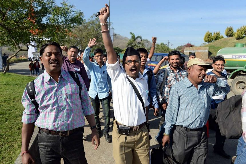 Volunteers from Rashtriya Swayamsevak Sangh (RSS) shouting slogans as they arrive for a rally in Pune on Jan 3, 2015.