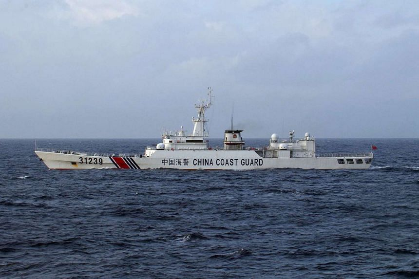 A Chinese Coast Guard ship is seen near the disputed islets known as the Senkaku islands in Japan and Diaoyu islands in China, in a photo handed out on Dec 22, 2015.