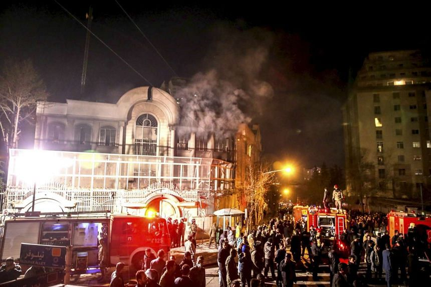 Flames rise from the Saudi Arabian embassy during a demonstration in Teheran on Jan 2, 2016.