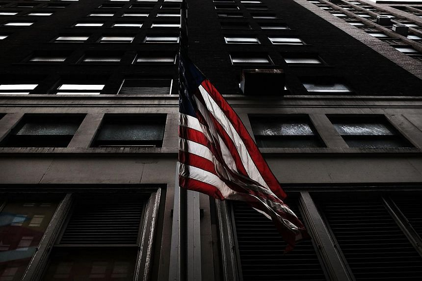 An American Flag hangs from a building along Eighth Avenue at 35th street on Nov 11, 2015 in New York, US.