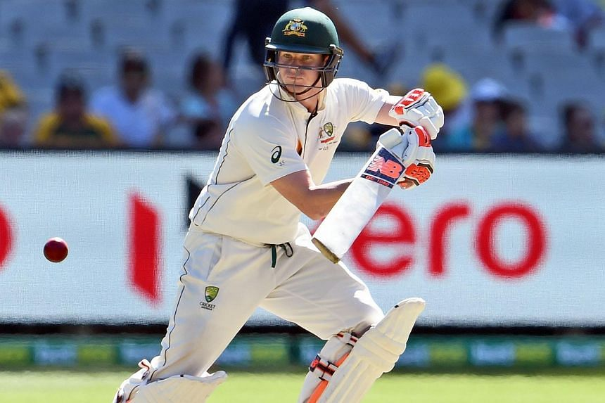 Australian batsman Steve Smith steers a ball away from the West Indies bowling on the third day of the second cricket Test in Melbourne on Dec 28, 2015.