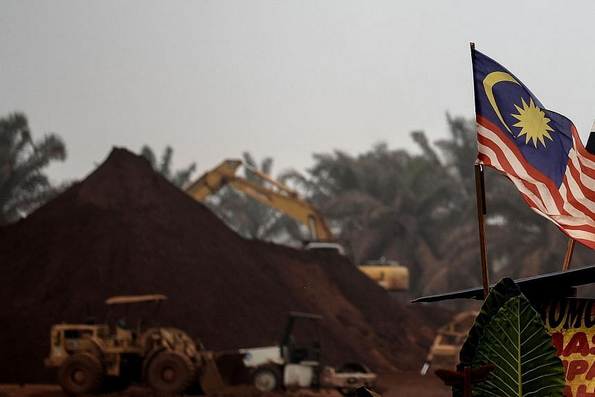 A Malaysian flag flies at the entry-point to a Bauxite mining site in Bukit Goh situated in Malaysia's rural state of Pahang on Oct 13, 2015.
