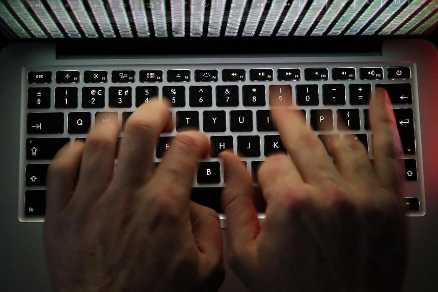 A man works to enter data on the computer keyboard in this arranged photograph.