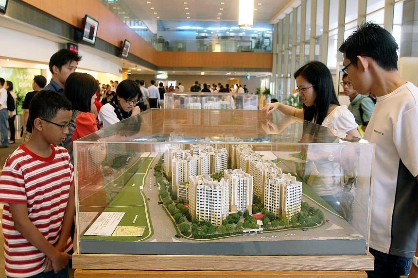 People viewing models of flats at Sunshine Gardens at the HDB Hub in Toa Payoh on March 28, 2012.
