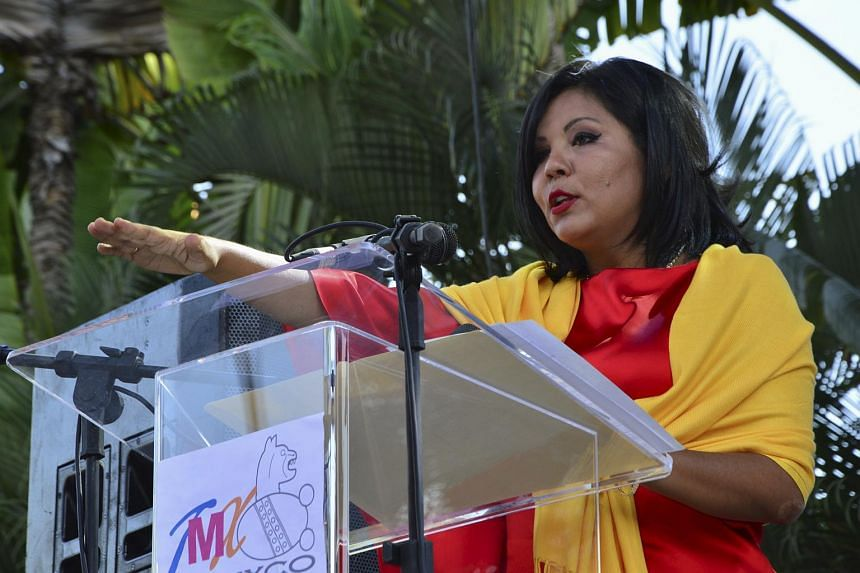 Gisela Mota, new mayor of Temixco takes her oath of office during a swearing-in ceremony.