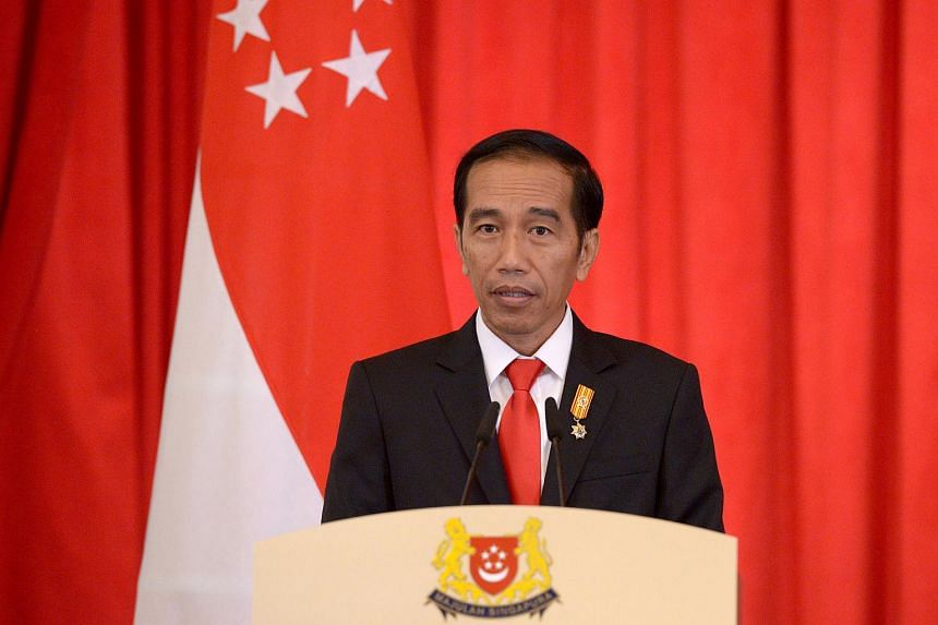 Indonesian President Joko Widodo speaking at a joint news conference at the Istana Presidential Palace in Singapore on July 28, 2015.