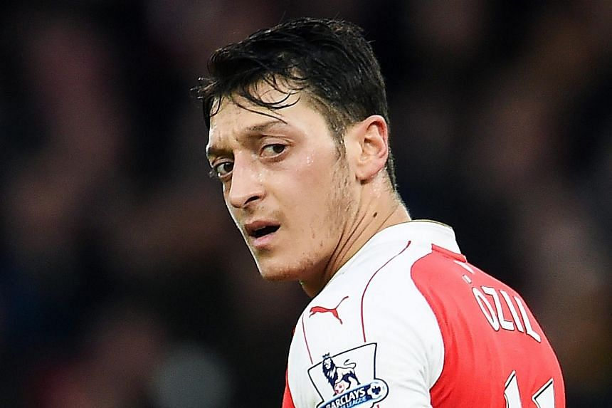 Arsenal's Mesut Oezil during the English Premier League soccer match between Arsenal FC and Newcastle United in London on Jan 2.