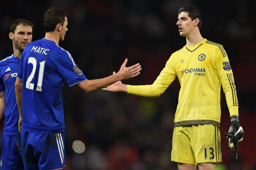 Chelsea's Thibaut Courtois (right) and Nemanja Matic (left) react after the English Premier League soccer match between Manchester United and Chelsea at Old Trafford, UK on Dec 28.