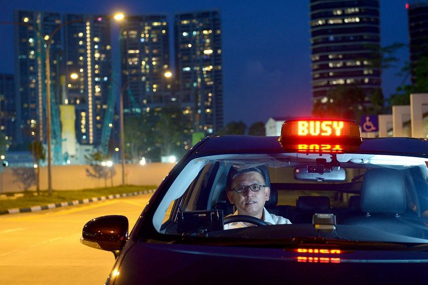 Straits Times Manpower Correspondent Toh Yong Chuan in a taxi which he drove during a two-week stint.