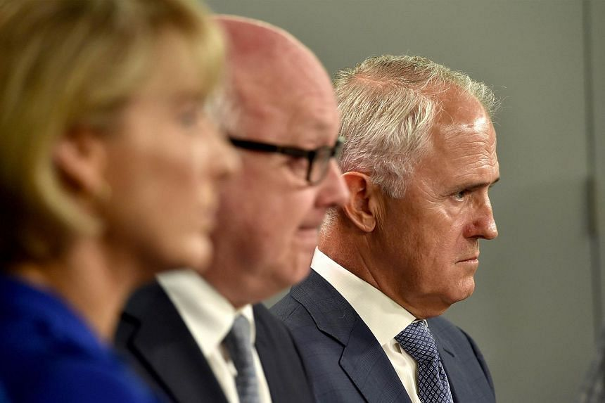 Australia's Prime Minister Malcolm Turnbull (left), Attorney General George Brandis (centre) and Minister for Employment Michaelia Cash listen to a question during a press conference in Sydney on Dec 30, 2015.