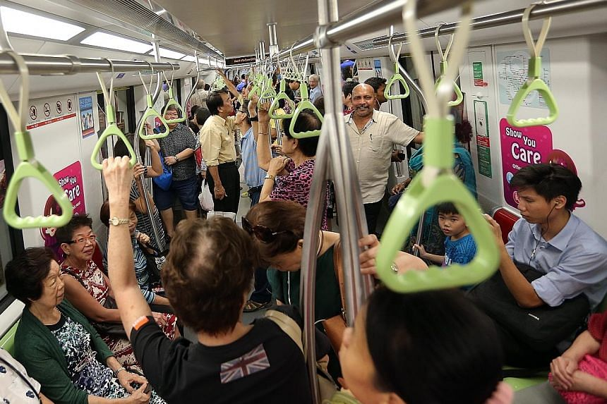 Commuters taking a ride on the Downtown Line 2 last Sunday, the first day it was opened to the public. This year will see improvements to the nation's rail transport system, including upgrades to the signalling system along the North-South Line and t