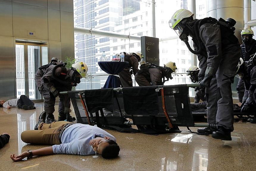 The Singapore Civil Defence Force taking part in Exercise Northstar outside the Singapore Sports Hub last year. Some 2,000 people were involved in the mock staging of a multiple terror attack. An annual anti-terror exercise led by the Home Team in No