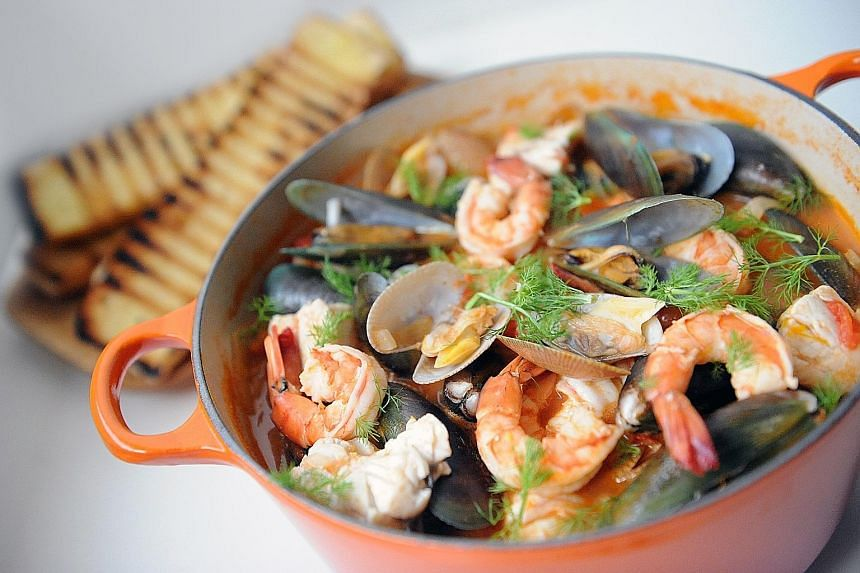 Large tiger prawns and firm seabass are a must in this seafood stew.