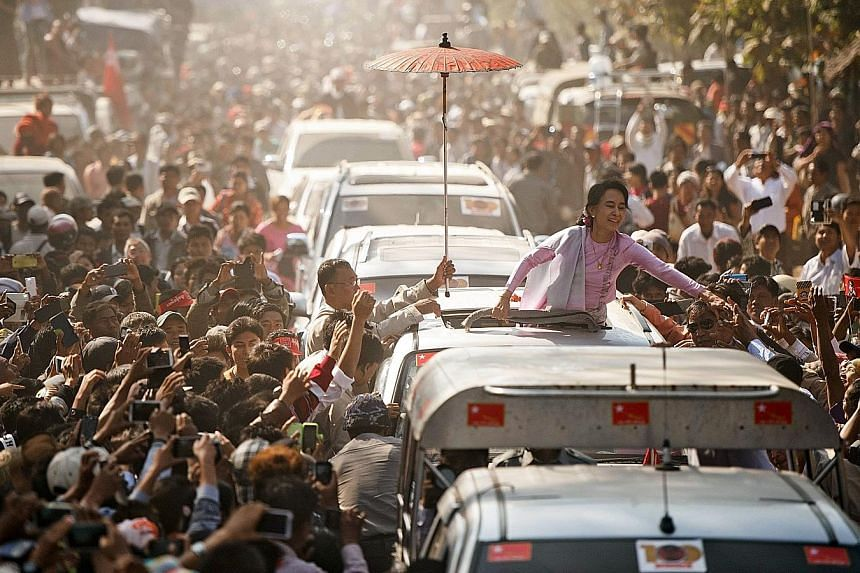 In Myanmar, two key issues - civil-military relations under a National League for Democracy government headed by Ms Aung San Suu Kyi (above), and peace talks with armed ethnic minority groups - and the way they are managed will be crucial to the coun