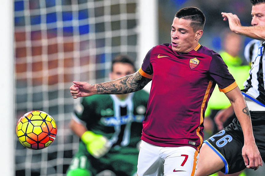 Bournemouth have signed Roma winger Juan Iturbe (in red) on loan for the rest of the season.