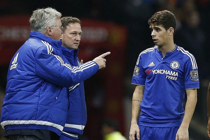 Interim manager Guus Hiddink (left, with first-team coach Steve Holland at Old Trafford on Monday) giving instructions to Oscar, who missed a penalty against Watford on Boxing Day. Chelsea's players will have to lift their game against a resolute Cry